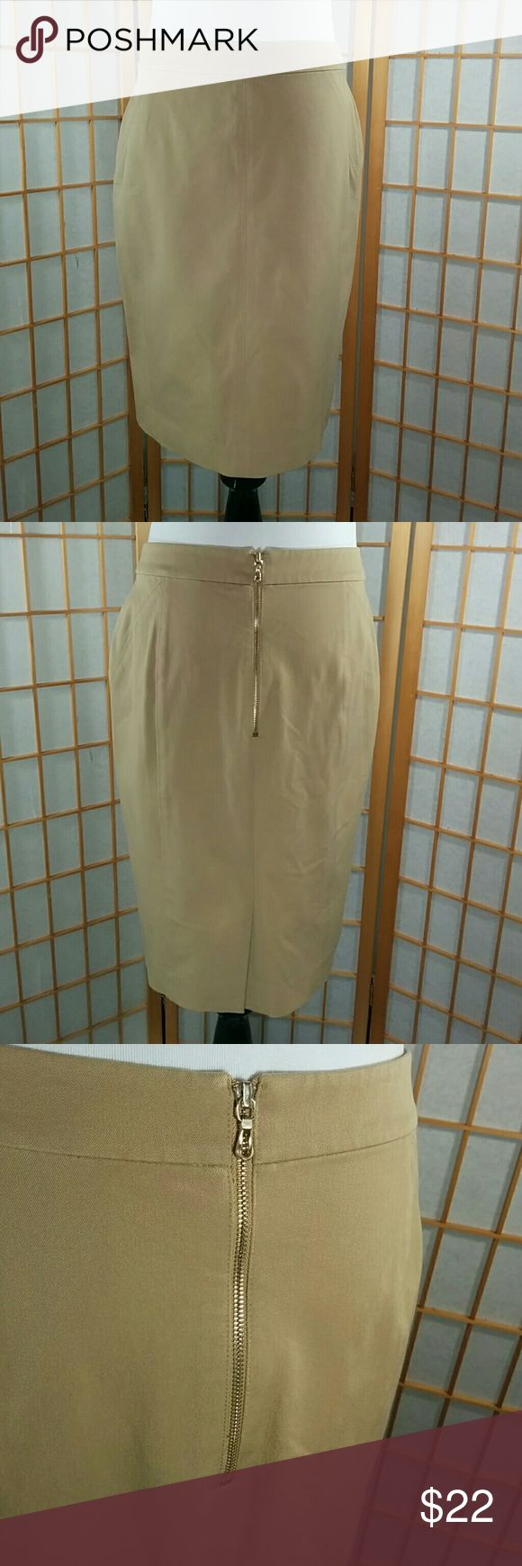 "Ann Taylor Petites, tan pencil skirt Ann Taylor Petites tan pencil skirt with a great gold zipper in the back. Excellent used condition. Skirt measures 14"" across the waist when laid flat, 20""long and has a a 5"" slit in the back. Ann Taylor Skirts Pencil"