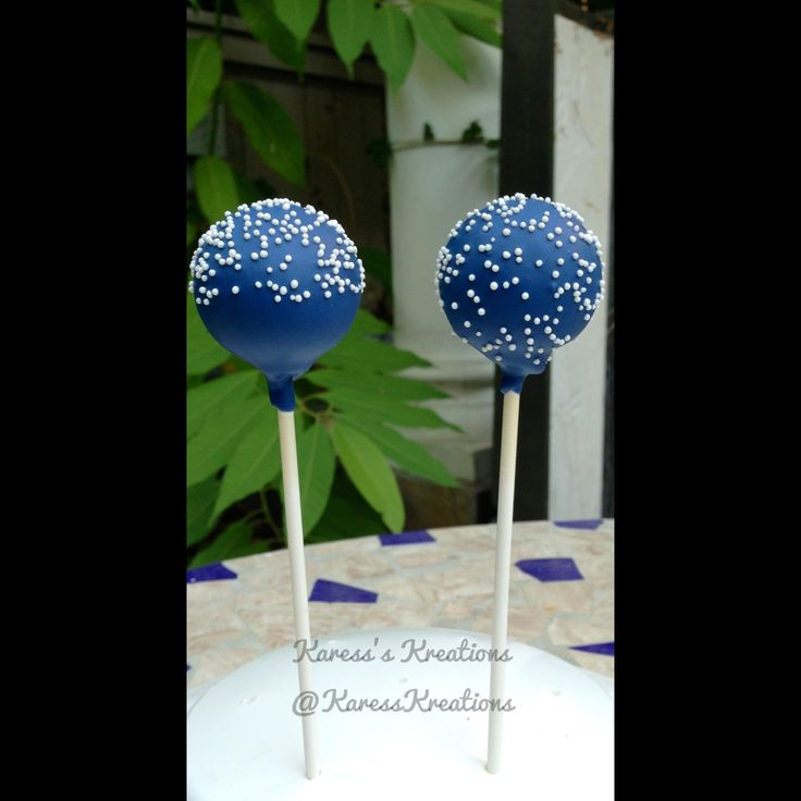 Navy blue cake pops with white nonpareils
