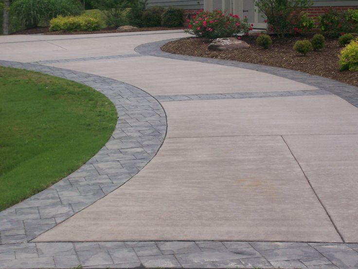 DRIVEWAY WITH STAMPED CONCRETE                                                                                                                                                      More