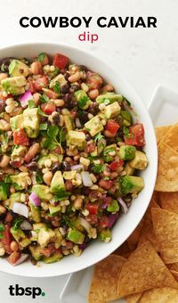 With black-eyed peas, corn, black beans, onion, tomato and avocado, this fresh + filling dip might just be the best cowboy caviar out there.