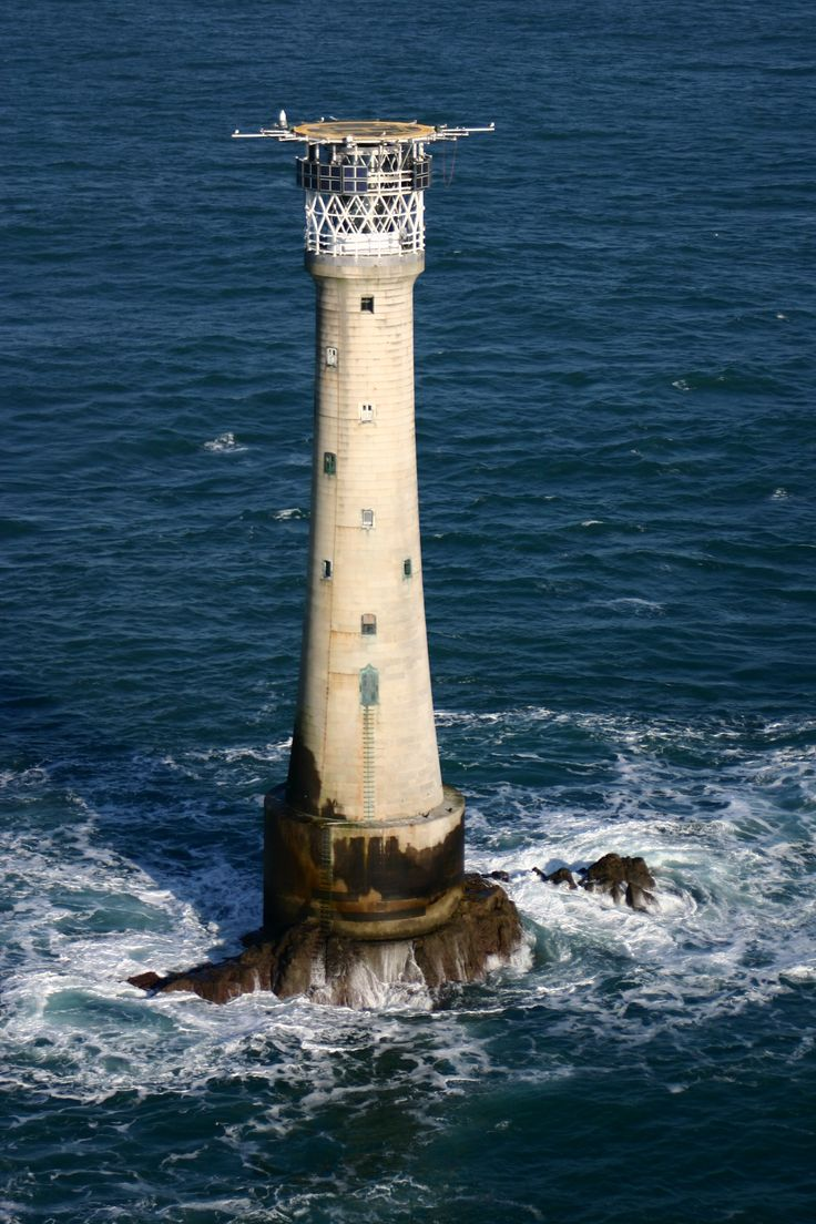 """Bishop Rock Lighthouse is referred to as """"King of the Lighthouses"""" and it is indeed a very impressive structure. It is the second tallest in Britain, and it has 10 floors with spiral staircase to the 2nd floor with a door made from gun metal. The 6th floor is the living room for the keeper, with window and 7th floor is his bedroom with window. This lighthouse lies 28 miles off the Cornish coast of Britain. It is the smallest island in the world per the Guinness Book of World Records."""