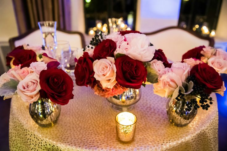 These fall wedding centerpieces feature rich velvety red roses, amaryllis, rustic hydrangea, beautiful pink garden roses, and deep pink calla lilies. Stapleton Floral Design | Custom Floral Design | Wedding Florist | Boston Florist | Alden Castle | Karen Kelly Photography