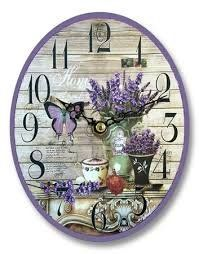 This stunning small oval purple butterfly with lavender flowers wall clock is a stylish addition to any home Made from quality materials The clock