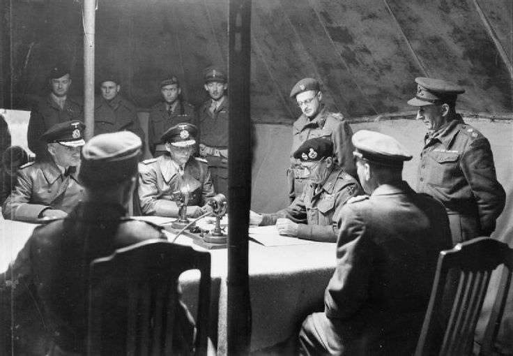 Hans-Georg von Friedeburg, commander-in-chief of the German Kriegsmarine, and the British Field Marshal Bernard Montgomery, sign the German armed forces kapitulation in Holland, northwest Germany, Frisian Islands, Helgoland, Schleswig-Holstein, and Denmark. Dated 4 May 1945.