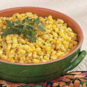 Herbed Corn - Serves 12-14 12 cups frozen corn 1 cup water 1/2 cup butter, cubed 2 tablespoons minced fresh parsley 2 teaspoons salt 1 teaspoon dill weed 1/2 teaspoon garlic powder 1/2 teaspoon Italian seasoning 1/4 teaspoon dried thyme