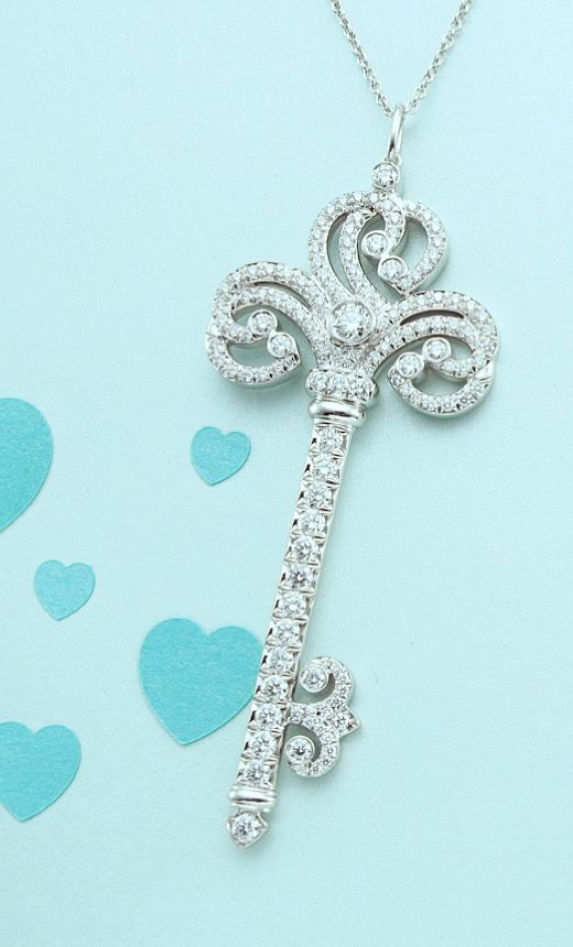 Unlock love's mysteries. Tiffany Enchant® heart key pendant in platinum with diamonds.