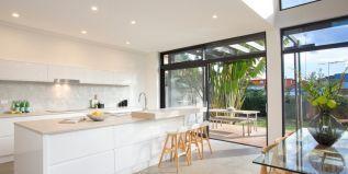 breakfast bar, tiled splashback, European styled timber laminate bench tops, polished concrete floors