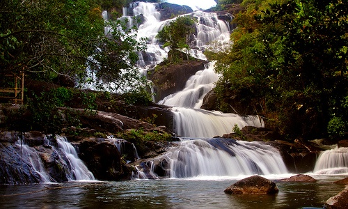 Temburun waterfall, Anambas Island, Riau Islands, Indonesia. The waterfall is very unique, terraced shape, seven levels and lead to Peniting Strait. At the mouth of the waterfall, there are mangrove ecosystem which consists mainly of mangrove (Rizophora), with a substrate of mud.