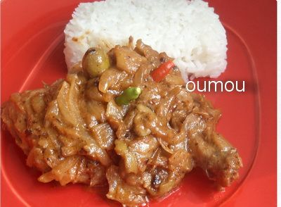 Chicken Yassa Recipe - Chicken Yassa is a Senegalese stew which is also known as Yassa au poulet. Site includes a video too. It looks like the photo has green olives included, though I didn't see them as a listed ingredient.