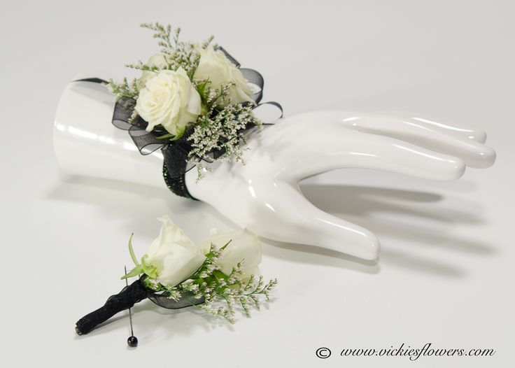 White Rose wrist corsage and boutonniere wrapped with ...