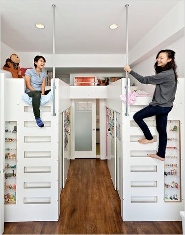 Despite its small size, this bedroom shared by two girls in a Noho loft has lots of smart storage space. Closets are located underneath the loft beds.