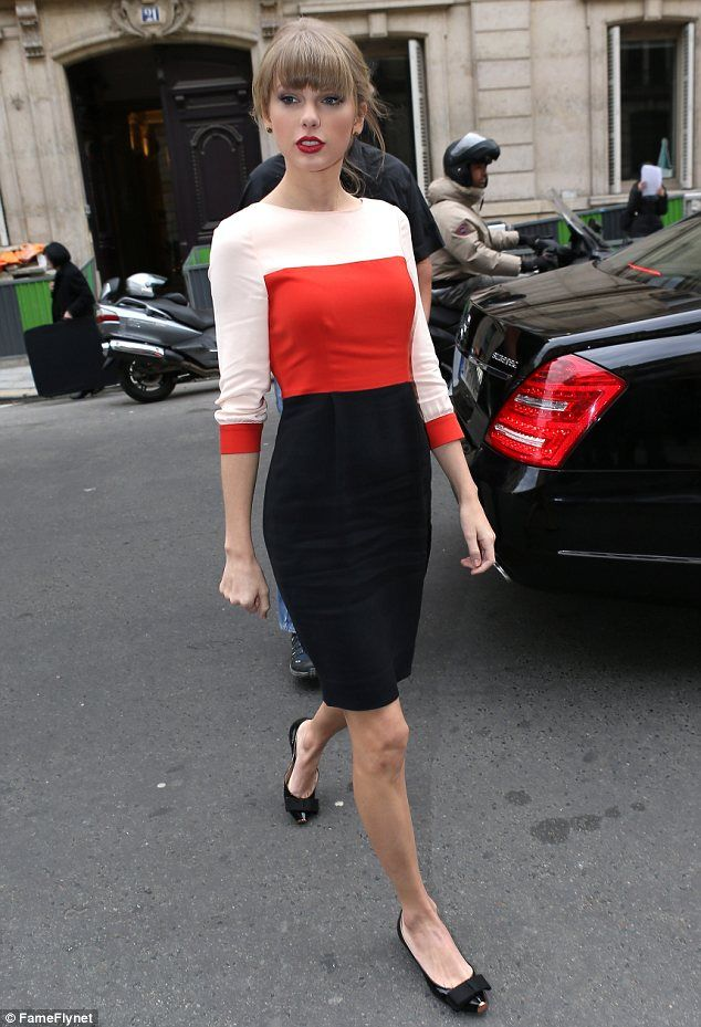 Taylor Swift in Paris wearing red, white and black shift dress.