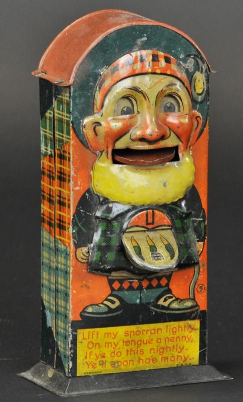 "SCOTSMAN TIN MECHANICAL BANK Selhumer & Strauss, Germany. ""Lift my sporran lightly, On my tongue a penny, If ye do this nightly, Ye'll soon ha'e many."" Some denting, (Exc. Cond.)"