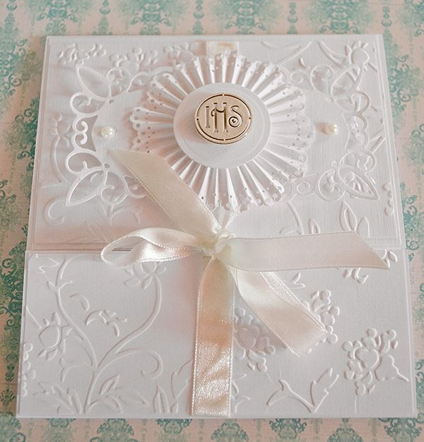 handmade card ... white on white ... beautiful embossing folder texture ... layered rosette ornament ...delightful!