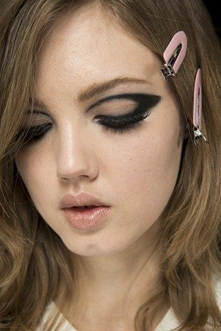 I love doing this look...reminiscent of the 60's, easy to do and a minimalist take on a smokey eye
