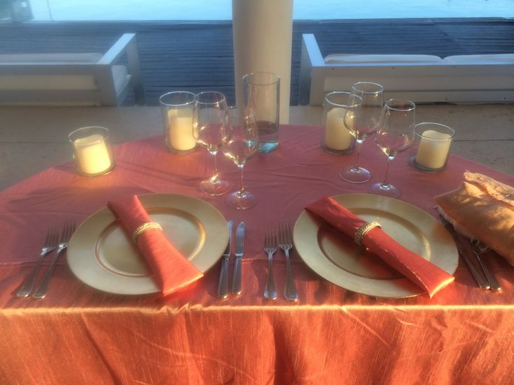 Coral Satin Table Cloth With Gold Plate Chargers And Coral Napkins With  Jeweled Napkin Rings Overlooking