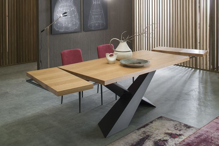 Table LIVING (extendible version): table with two tilted steel legs overlapped in asymmetric way painted graphite. Extendible on both sides with 2 extensions, width 40 cm.