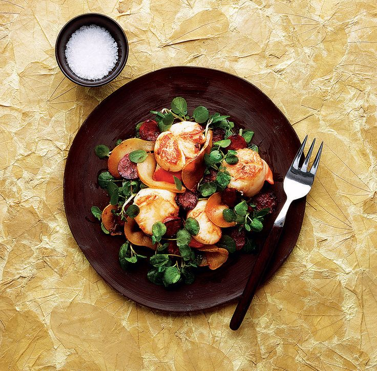 This pear, scallop and chorizo dish is a warm salad that's quick, easy and ideal for serving at a dinner party.