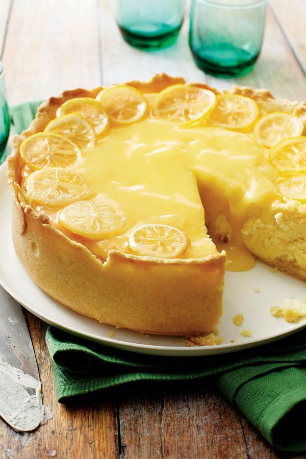 Lemon Bar Cheesecake - To-Die-For Cheesecake Recipes - Southernliving. This indulgent recipe marries two delicious desserts: lemon bars and cheesecake. Using a dark springform pan ensures a golden brown crust on this tart dessert recipe without having to bake before adding the filling. Garnish with Candied Lemon Slices.  Recipe:Lemon Bar Cheesecake