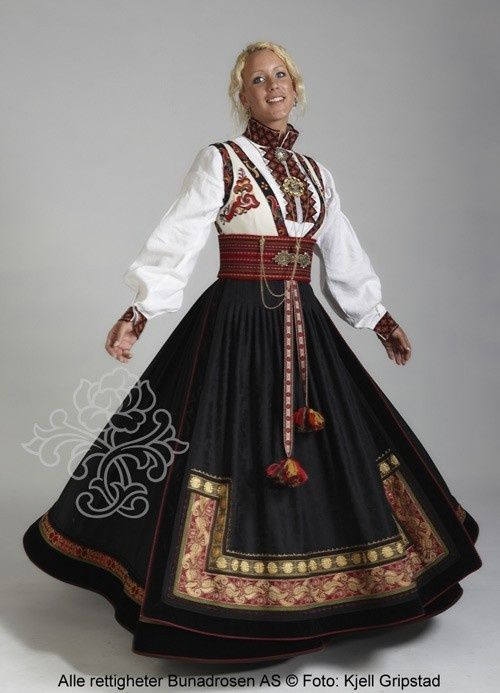 Norwegian woman in traditional dress of Norway.