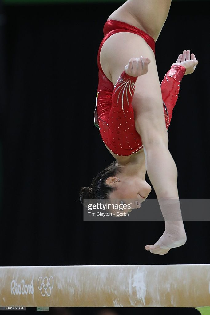 Day 6 Alexandra Raisman #395 of the United States in action on the Balance Beam during her silver medal performance in the Artistic Gymnastics Women's Individual All-Around Final at the Rio Olympic Arena on August 11, 2016 in Rio de Janeiro, Brazil.