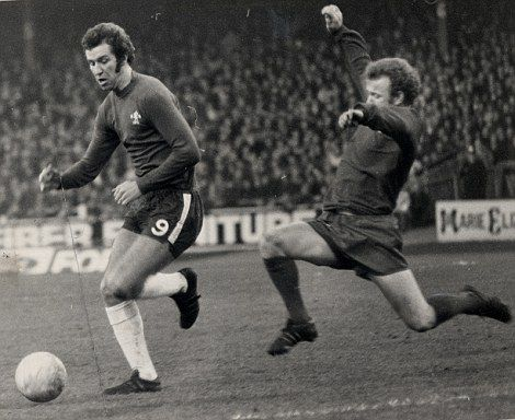 Billy Bremner (right) about to tackle Chelsea's Peter Osgood. Chelsea v Leeds (0-0)