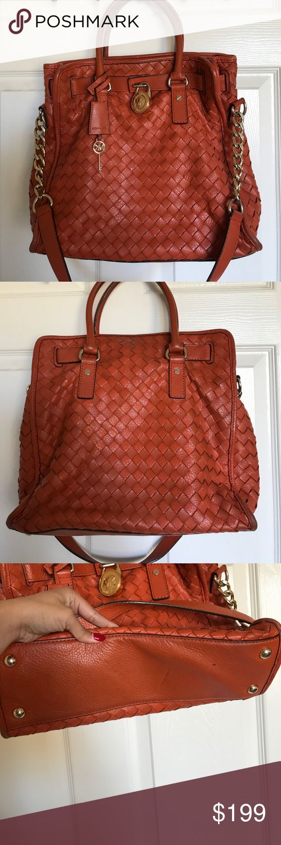 Michael KorA Large Woven Hamilton Tote Bag Beautiful burnt orange purse that can be used as tote of shoulder bag. As shown in photos, there are some signs of wear (scratches on gold and some gold wear). There are a few stains on side and bottom of bag (all shown in photos). 2 very small stains on front of bag. Inside has one zipper pocket and four open pockets. Few stains on inside of bag. Price negotiable. KORS Michael Kors Bags Totes