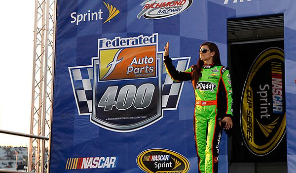 PHOTOS: Danica Patrick waves to the crowd during driver introductions for the Federated Auto Parts 400 at Richmond International Raceway. View more photos from Richmond here:  http://www.stewarthaasracing.com/fan/galleries/2013-federated-auto-parts-400/