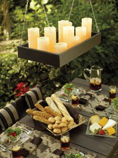 Brighten up your outdoor dining space with a #DIY #Candle #Chandelier.