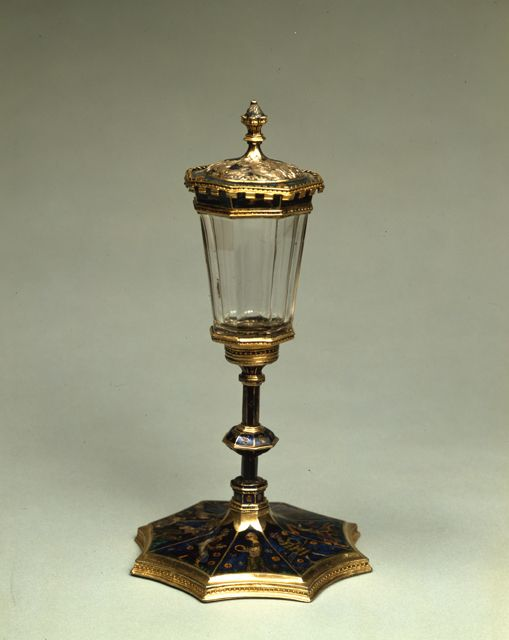Museo Poldi Pezzoli | This tournament cup was made by the cives orafi of Avignon. The octagonal base is totally covered by enamels with chivalry themes, as the scene with a tournament or the meeting of Tristan and Isolde spied by King Mark, whose face is reflected in a fountain water.