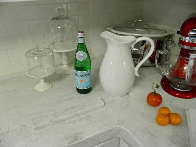 Who knew?? Corian Rain Cloud countertops are a dead ringer for Carrera marble! Just click through to read The Army Mom's experience with it.