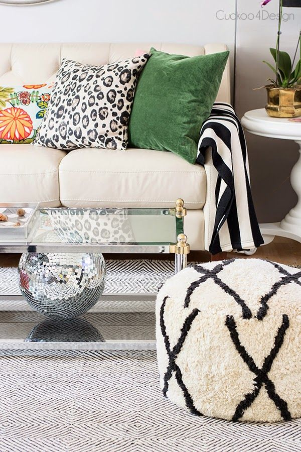 ivory, black and white living room with hint of emerald green and pops of orange and pink