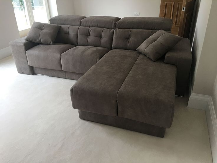 Versatile modern sofa with chaise. The habitat sofa offers sliding seats with storage to adjust the depth of seating. Chaise lounge can be deployed as an extra corner seating or a single bed with mattress cover. Armrest can also be deployed as extra seating. Delivered to our client in Surrey.
