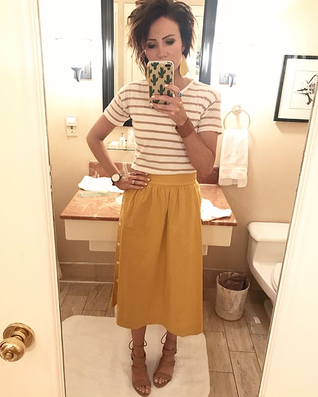 The color of this skirt is so good. It has buttons that run up both sides. Mustard skirt with stripes.