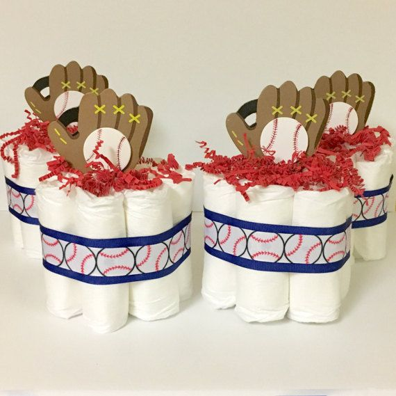 ****Like my Etsy Store and receive 10% discount on an order. Just Like /Follow my page and send me a conversation for the discount code. Once I have verified it I will send you the code. Thanks so much!**** These unique baseball mini diaper cakes make a memorable centerpiece, baby shower gift or it is great to take to the hospital room for the Parents to-be to welcome their new baby. Each cake is a single tier and includes: 8 hypoallergenic diapers, size 1 (8-14lb). - Measures 5 wide ...