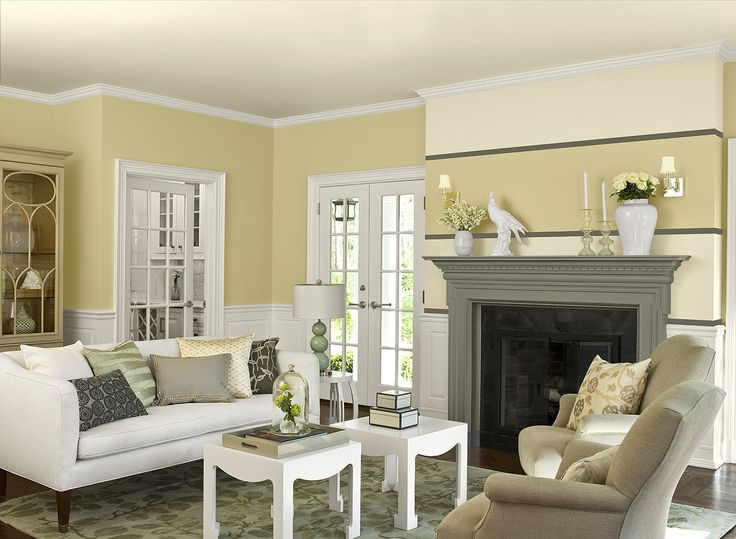 Benjamin Moore Paint Colors - Yellow Living Room Ideas - Fanciful, Formal Yellow Living Room - Paint Color Schemes . . . . . Two pretty shades of yellow deliver a double dose of style in this living room. . . . . . Walls - Harvest Time (186); Ceiling & Accent Stripes (top of fireplace & top of wall over fireplace) - Kansas Grain (2160-60); Fireplace Mantel & Accent Stripe (beside & above fireplace) - Desert Twilight (2137-40).