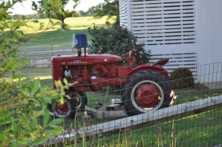 Tractor....classic red; looks like it's done a lot of work.