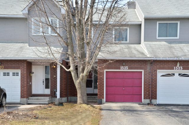 $269,900 Or Trade This home is truly move in ready.  Newer furnace 2015, newer roof 2006, newer windows in 2014.  Bright, freshly painted 3 bedroom, townhouse with attached garage, with no rear neighbours!!  Updates to large kitchen and all shiny appliances included.  Main floor boasts hardwood in dining and living area with cozy wood burning fireplace (WETT certified)  Enjoy the finished lower level for extra family space.  All this, no condo fees and all backing into the greenspace.