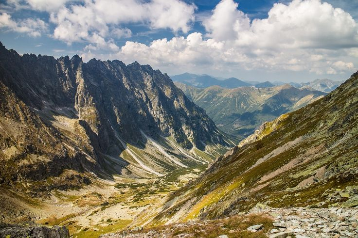 In this photo you can nicely see the difference between the High and the West Tatras. While the peaks of the High Tatras are sharp, the peaks in the West Tatras are rounded and you can do the ridge hikes there. You can see the West Tatras in the distance.