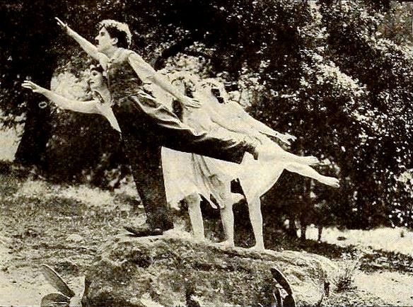 Still from the American film Sunnyside (1919) with Charlie Chaplin and the wood nymph
