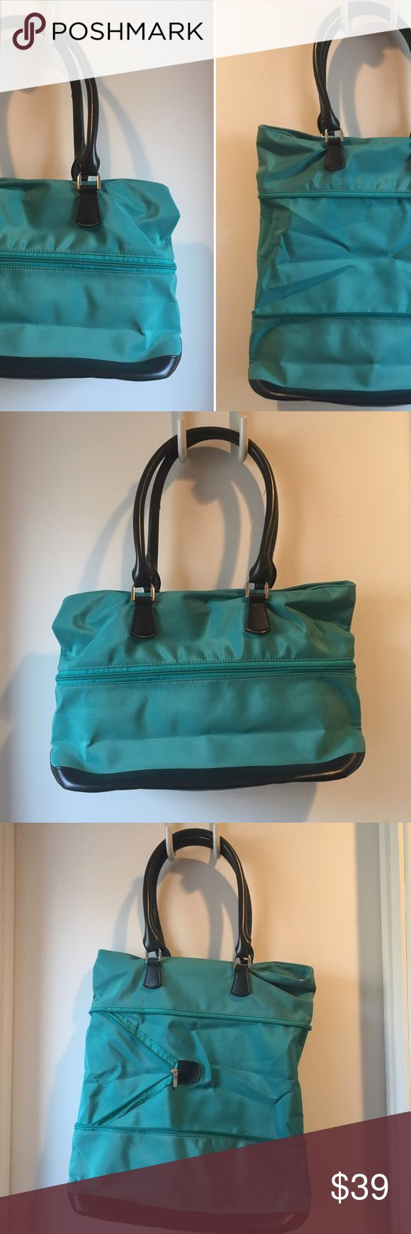 Expandable nylon tote bag Cool expandable tote bag. Teal blue green color with black shoulder straps and bottom. The zipper on outside unzips to expand bag. Thick water resistant nylon fabric with vegan leather bottom and straps. Inside has one zip pouch and three pockets. Great for travel and as a carryon! Or for a laptop. Excellent condition.  Zippered up: 16x11x5 inches  Unzipped: 16x18x5 inches Bags
