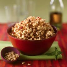 Mediterranean Popcorn - Popcorn and toasted pine nuts are tossed with a buttery glaze made with sun-dried tomatoes, olive oil and Italian herbs to create a delightful Mediterranean-flavored snack mix.