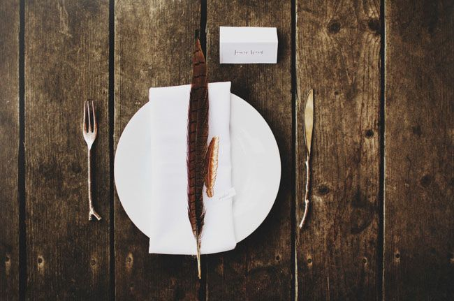 a simple feather makes a great place setting statement