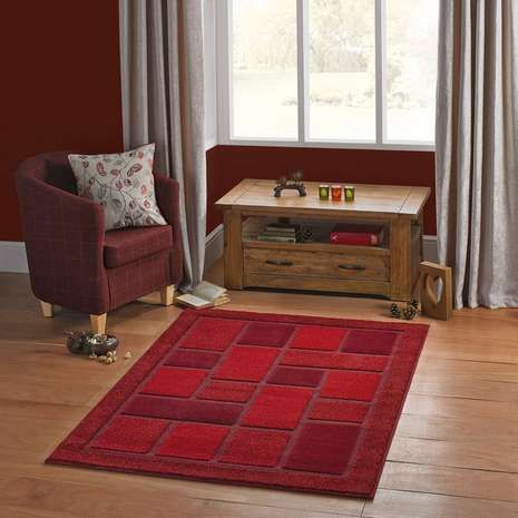 Crafted with a carved pile for a textured and embossed effect, this geometric rug is fabricated from durable materials and is ideal for high traffic areas, available in a choice of colours and sizes for your preference.