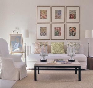 Fabric in frames over the couch becomes a focal point in this room.