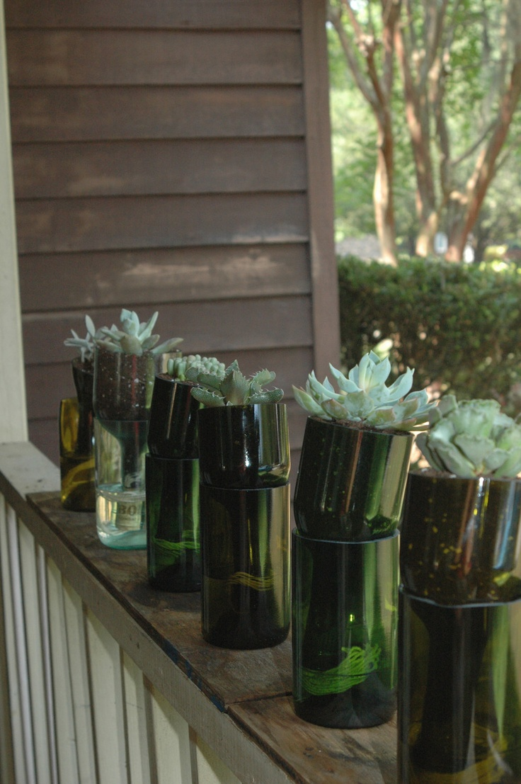 The big list of self watering planters for stylish gardening anywhere - Self Watering Planter Made From Recycled Wine Bottle