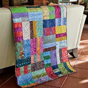 Second Floor Walk-up: Super-Quick Cool Scrap Lap Quilt Pattern Designed by SUSAN GUZMAN Machine Quilted by LINDA BARRETT , patterned in the McCall's Quilting special issue, America Love's Scrap Quilts Winter 2013/2014