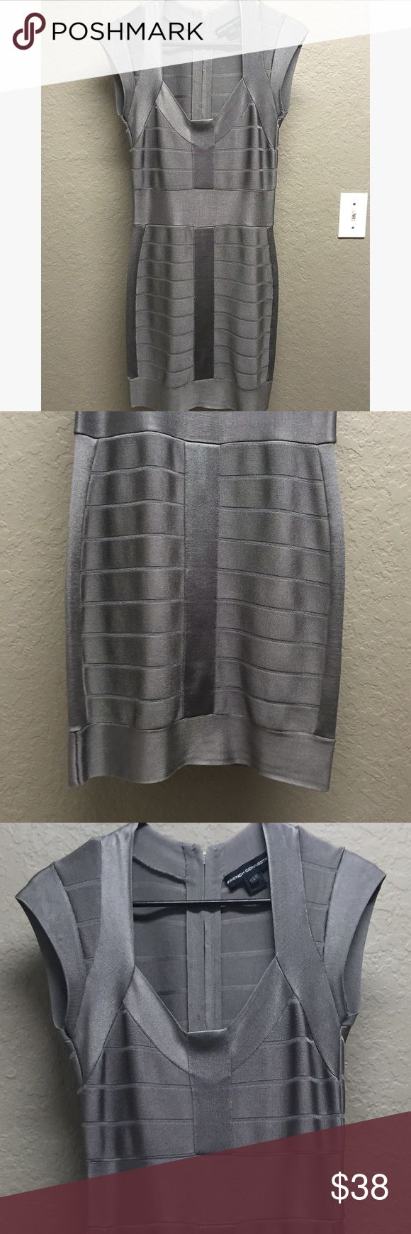 French Connection UK Bandage Bodycon Dress Silver Very flattering French Connection bandage bodycon dress in size 6. Authentic and purchased from Bloomingdales. Material is 79% Rayon, 18% Nylon, 3% Spandex. French Connection Dresses Mini