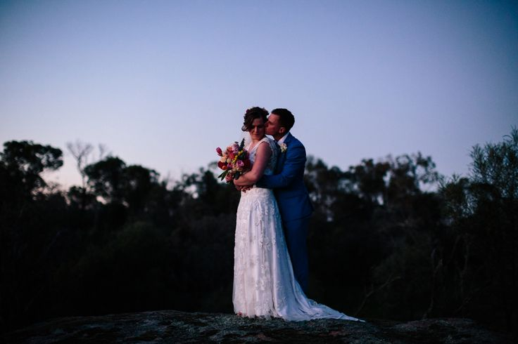 Bride and groom at sunset on top of a hill in country New South Wales.
