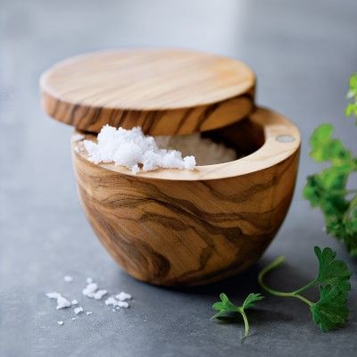 Each Olivewood Salt Keeper has a unique grain pattern with swiveling lid and magnetic latch keeps salt fresh and dry while allowing easy one-handed access. #williamssonoma  #williamssonoma